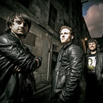 "GLASWEGIAN ROCKERS THE TOI TO RELEASE ""TOTALLY UNFASHIONABLE"" DEBUT ALBUM"